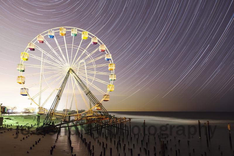 Startrails Looking North over the Ferris Wheel Iin Seaside park's Funtown Pier