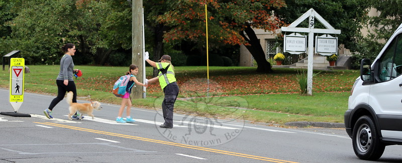 SH_Holick retiring as traffic agent -- directing traffic at Hawley 02 CROPPED