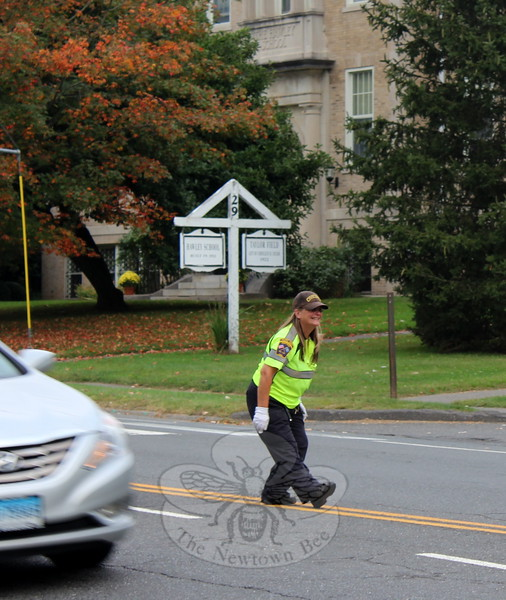 SH_Holick retiring as traffic agent -- directing traffic at Hawley 05 CROPPED