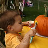 EH_ Newtown Arts Festival, Mason Kisker painting a pumpking as fundraiser for NHS Color Guard