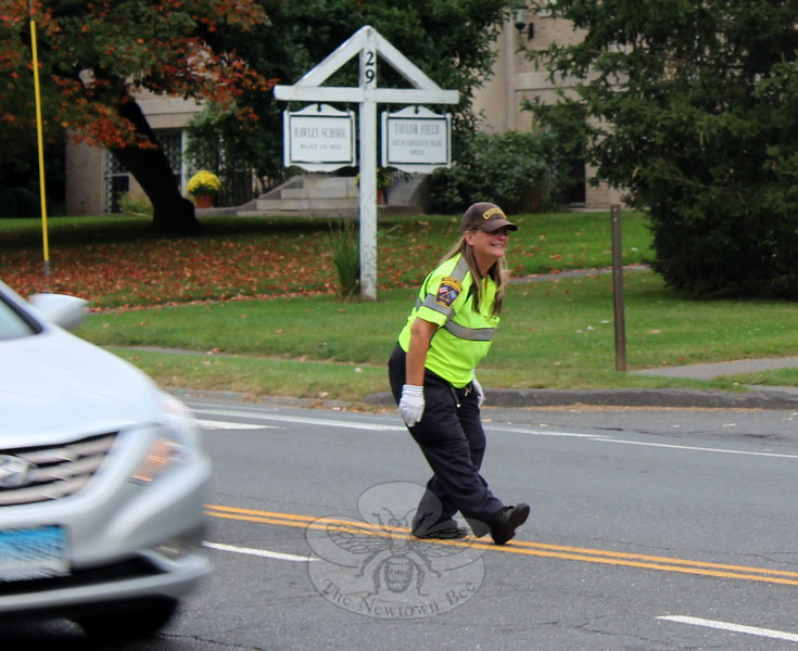 SH_Holick retiring as traffic agent -- directing traffic at Hawley 05 CROPPED FURTHER