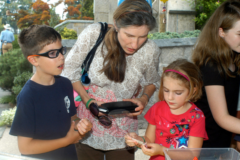 Jillian Cruwys-Hayes with her children Max and Eleanor at the Ben's Bells station at the ice cream social at Trinity Episcopal Church on August 31. (Hutchison photo)