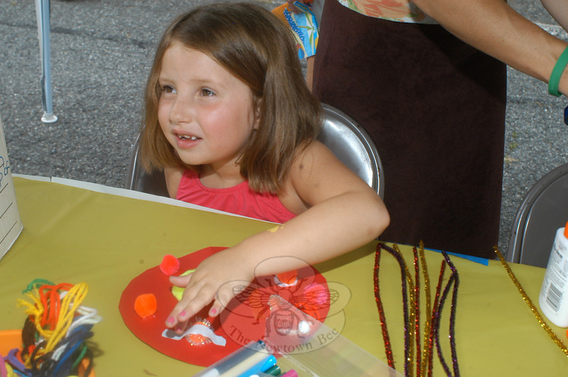 Alicia Ligouri at the Emerald Sketch Art Therapy station at the ice cream social at Trinity Episcopal Church on August 31. (Hutchison photo)