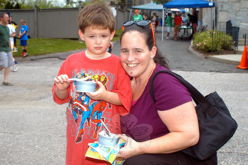Kerry Murray and her son Daniel take a break with their ice cream at the ice cream social at Trinity Episcopal Church on August 31. The three-hour event last Saturday afternoon was the latest offering presented by Ben's Lighthouse. (Hutchison photo)