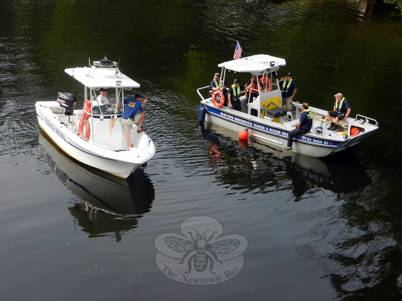 At Lake Zoar on September 1, police worked with members of Newtown Underwater Search And Rescue (NUSAR) and the Lake Zoar Authority Marine Patrol in a search for clues in the disappearance of Robert Hoagland, 50, of Glen Road, who went missing in late July. The two agencies' boats seen from the Silver Bridge traveled on Lake Zoar between Rochambeau Bridge and the Shady Rest section of Sandy Hook. The effort turned up no clues on Mr Hoagland's whereabouts, police said. (R. Scudder Smith photo)