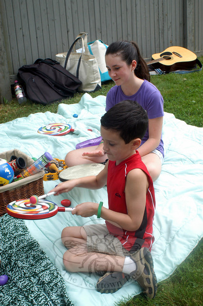 Joshua and Kelsey Hayel play musical instruments during the August 31 ice cream social at Trinity Episcopal Church. (Hutchison photo)