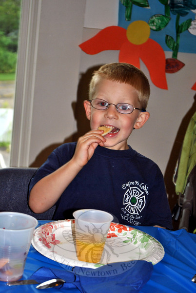 Gavin Boyle, age 5, enjoys the pancake breakfast hosted by Newtown Congregational Church prior to the Newtown Labor Day Parade, Monday, September 2. The Newtown Congregational Church offers pancakes and parking to paradegoers, each Labor Day, beginning at 8 am.