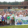 "Kevin Bresnahan (with glasses on head behind banner), a longtime friend of Newtown's Kowalski family, whose son Chase was one of the children killed on 12/14, is surrounded by more than 100 friends and supporters September 1 as he prepares to run his 1,000th mile from the entrance of Sandy Hook and Chalk Hill Schools in Monroe. He was joined by Rebecca, Steve and Brittany Kowalski, Sandy Hook neighbors Bob, Tracy, Cole and Kayla Terry, Carl Baumann, and Kevin Grimes. Mr Bresnahan was inspired by Chase, a developing runner who by age 7 had already completed and won the Kids Who Tri Succeed triathlon. He hopes to raise funds toward the construction of one or more community centers named in memory of the late Sandy Hook School student. He will also ""Race for Chase""' during the New York City Marathon November 3. (Voket photo)"