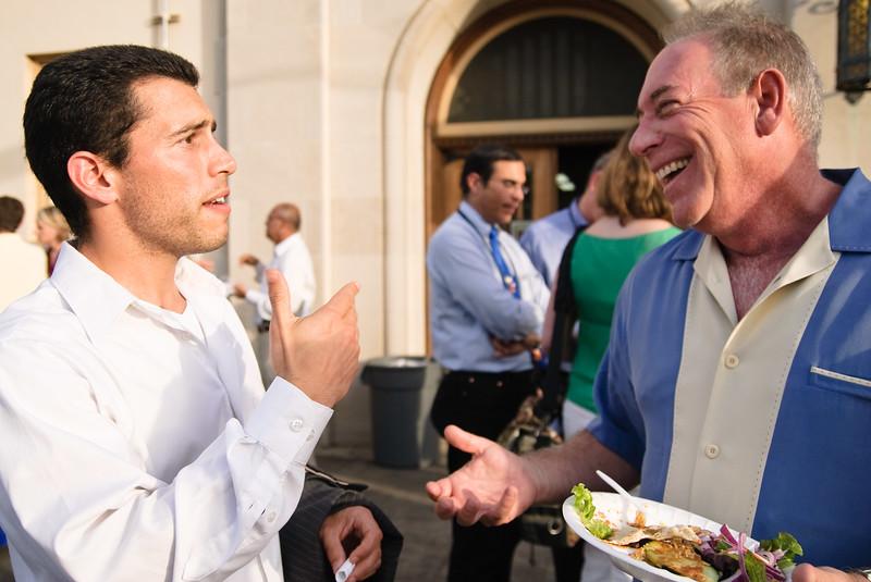 "Portugese Singularity student Nuno Martins (left) chatting with ""Future Guru"" James Canton."