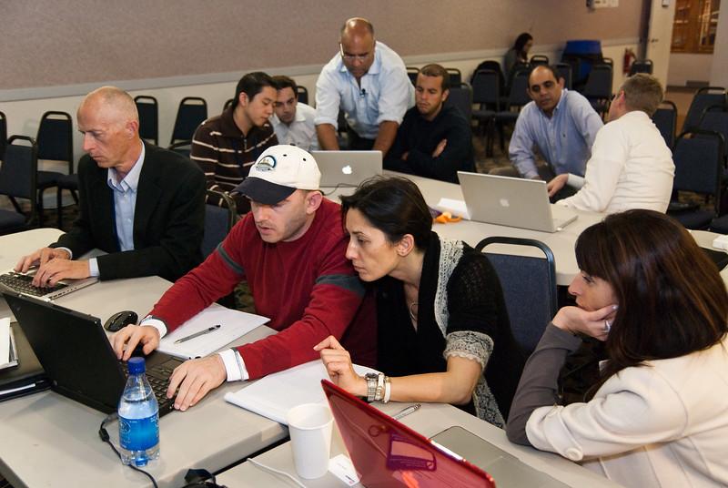 Peter Platzer and Jihan El Gazzar lean over a laptop while discussing CO2 emissions estimates. Sherine El Gazzar is watching. Left: fellow group member James Clement.