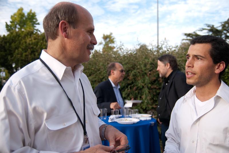 Stanford professor Paul Saffo (left) in conversation with Nuno Martins.