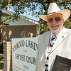 Jim Kizzia stands in front of Norwood Lakeview Baptist Church, where he now pastors