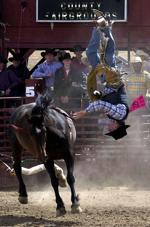 Hagan Miller looks for a soft landing spot during the bareback riding competition of the 2002 Idaho State High School Rodeo Finals at the Bannock County Fairgrounds in Pocatello, Idaho on Saturday, June 22, 2002. AP Photo/Idaho State Journal, Bill Schaefer (IDPOC101). Mags out.