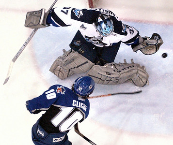 2/19/04  Russ Dillingham/Sun Journal Rimouski goalie Guillaume Lavalle flashes his glove to rob Lewiston Maineiacs Marc-Andre Cliche of a goal in the first period of Thursday night's game at the Colisee in Lewiston.