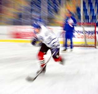 Russ Dillingham/Sun Journal A Lewiston High School hockey team candidate picks up some speed during a drill at the team's first practice of the season at the Androscoggin Bank Colisee Monday afternoon.  Nearly 50 players were trying out for the team.