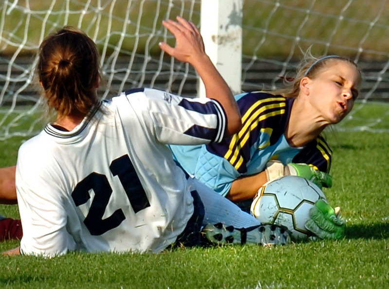 Freeport goalie Tasha Sanders makes a save on Poland's Jennifer Baril as she makes a bid for her fourth goal and preserving a 3-3 tie.