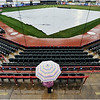 Debbie Senft, 46, of Millcreek Township, Pa. stands under her umbrella at Jerry Uht Park in Erie, Pa. before the start of a rain-delayed baseball game between the Erie SeaWolves and the Bowie BaySox on Monday, April 14, 2014. The 6:35 p.m. game was delayed more than two hours, eventually starting at 8:53 p.m. Senft waited out the storm as well.