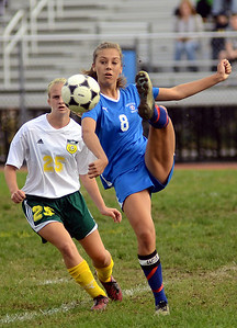 10/8/12 Wrentham- Hopedale's Lauren Kapatoes (right) redirects the ball down field in front of King Philip's Erin Machado (left) during Monday afternoon's game. Photo by Sean Browne, MetroWest Daily News