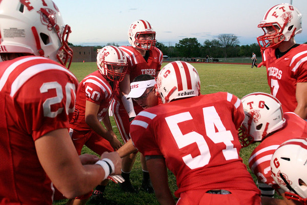 Fort Gibson's defensive line coach Sammy Johnson, center, finishes with his pep talk during the first half of Friday's game versus Tahlequah. Special photo by Jasmier Jones