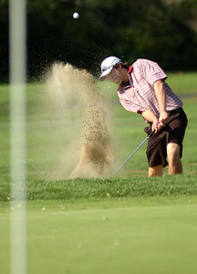 9/23/10 Easton- Sharon's Jake Dennis blasts his way out of the bunker on the first hole during Wednesday afternoon's match versus Stoughton. Photo by Sean Browne, Sharon Advocate