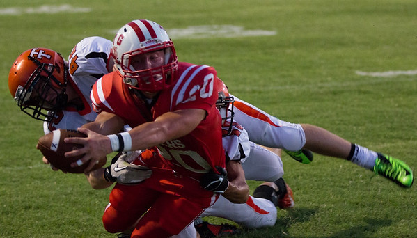 Fort Gibson's Jake Gandara lunges through the tackle of Tahlequah's Charles Mounce for a touchdown during Friday's game in Fort Gibson. FGHS won 40-20. Special photo by Von Castor<br /> Jake Gandara TD (FG) Charles Mounce (Tahl) (VC).tif