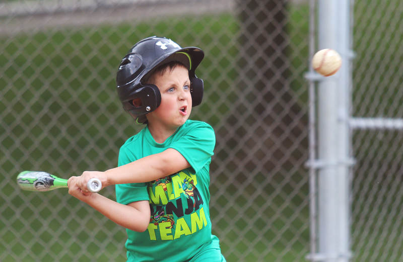 6-year-old Caleb Kimmell, of Fairchance, prepares to clobber the baseball at T-ball practice at Areford Park on Monday, June 15th.