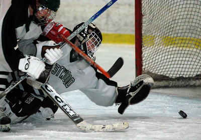 2/13/06 Canton- Westwood goalie, Joe Mauer, nearly deflects a shot into his own goal but is able to recover and knock the puck away.  Photo by Sean Browne, Daily News Transcript