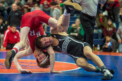 Cambridge High School's Eli Zibelo (r) throws Bridgewater-Raynham High School's Luke Corboy during their 120 pound match at Newton South High School during Saturday morning's 2018 MIAA D1 High School State Tournament, February 17, 2018.  [Wicked Local Photo/Sean Browne]
