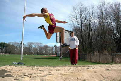 5/1/07 Sharon- Sharon's Justin Rodriguez competes in the long jump during Tuesday evening's track meet versus Canton. Photo by Sean Browne, Sharon Advocate