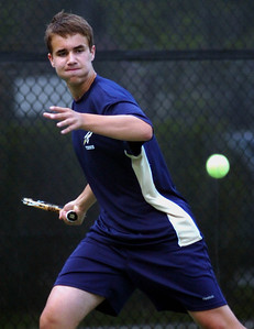6/13/11 Newton- Needham's Aaron Revzin lines up his return to Saint John Prep's Cameron Trosin during their first singles match Monday afternoon. Photo by Sean Browne, Needham Times