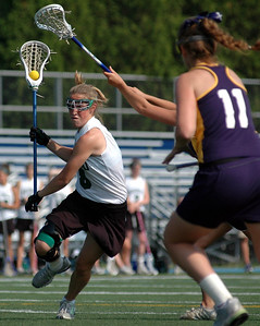 5/31/06 Westwood- Westwood's Sara Harrington pushes the ball through the Needham defense during Wednesday afternoon's game.  Photo by Sean Browne, Daily News Transcript