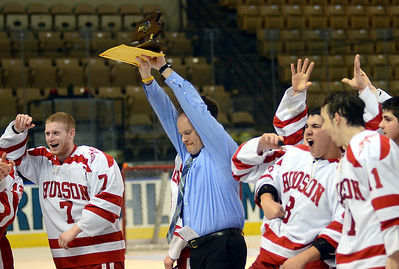 3/12/12 Worcester- Hudson Head Coach Michael Nanartowich holds up the State Title Trophy after defeating Wachusett in overtime of Monday evening's Division 3 State Finals at the DCU Center in Worcester. Photo by Sean Browne, MetroWest Daily News