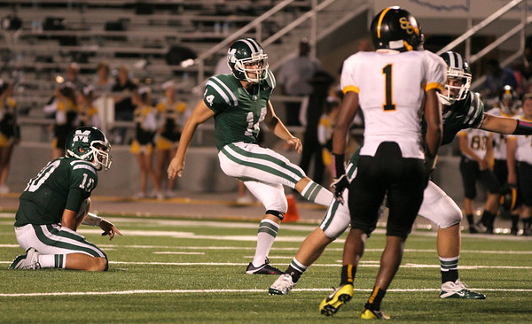 Muskogee kicker Preston Sopher kicks a 48-yard field goal Friday night in the MHS home opener against Sand Springs. The Roughers lost 40-28.