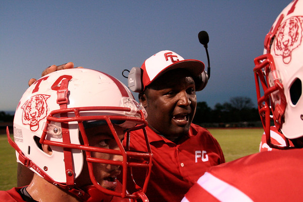 Fort Gibson defensive coordinator Kenyatta Wright, offers words of encouragement to his troops during Friday's game against Tahlequah Special photo by Jasmier Jones