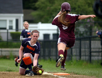 5/23/11 Dedham- Walpole's Kelsey Cosby picks a throw to first to get the out on Dedham's Paige Keefe during Monday afternoon's game. Photo by Sean Browne, Walpole Times