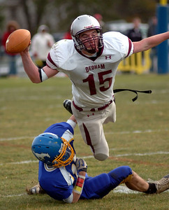 11/25/10 Norwood- Dedham's Dan O'Connor tries to get rid of the ball before being brought down by Norwood's Samuel Anderson during Thursday morning's Thanksgiving Day game. Photo by Sean Browne, Dedham Transcript