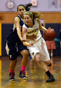 2/1/13 Needham- Needham's Kathleen Rizzo (right) dribbles the ball around Framingham's Tiana Souza (left) during Friday evening's game. Photo by Sean Browne, Needham Times