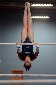 1/6/12 Westwood- Walpole's Sydney Gillis inverts herself on the bars during Friday evening's gymnastics meet versus Norwood. Photo by Sean Browne, Walpole Times
