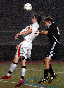 10/14/11 Walpole- Walpole's Conor Murtagh gets his head on the ball in front of Wellesley's Ryan Stuntz (right) during Friday evening's game. Photo by Sean Browne, Walpole Times