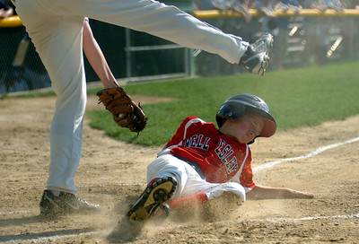 7/23/11 Norwood- Wellesley South's Jack Waisel slides under the tag of Medfield pitcher, Chris McGrury, while trying to cover home on pass ball during Saturday afternoon's game. Photo by Sean Browne, Wellesley Townsman
