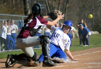 4/13/12 Norwood- Norwood's Kelly Duggan (18) beats the throw to the plate while Dedham's Sam Girard fields the ball during Friday afternoon's game. Photo by Sean Browne, Norwood Transcript and Bulletin