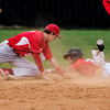 Hilldale's Dakota Holme's grabs the corner of second base on a steal as  Stigler second baseman Wade Henderson tries to apply a tag March 24 at Hornet field.