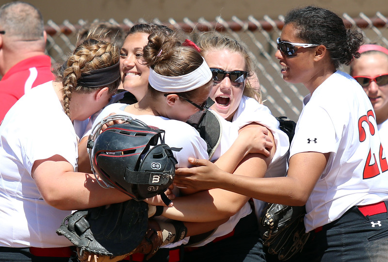 Southmoreland celebrates winning 7-1 over Hampton and advancing in the playoffs.