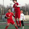 Hilldale's Bailey James heads a ball as Wagoner's Bryce Brown and Hilldale's Brian Martinez look on March 25 at Bulldog Stadium in Wagoner.