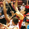 Fort Gibson's Zack Lindley shoots over Stigler's Dylan Bryant.