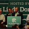 At the podium: State Senator Linda Dorcena Forry and Governor Deval Patrick.