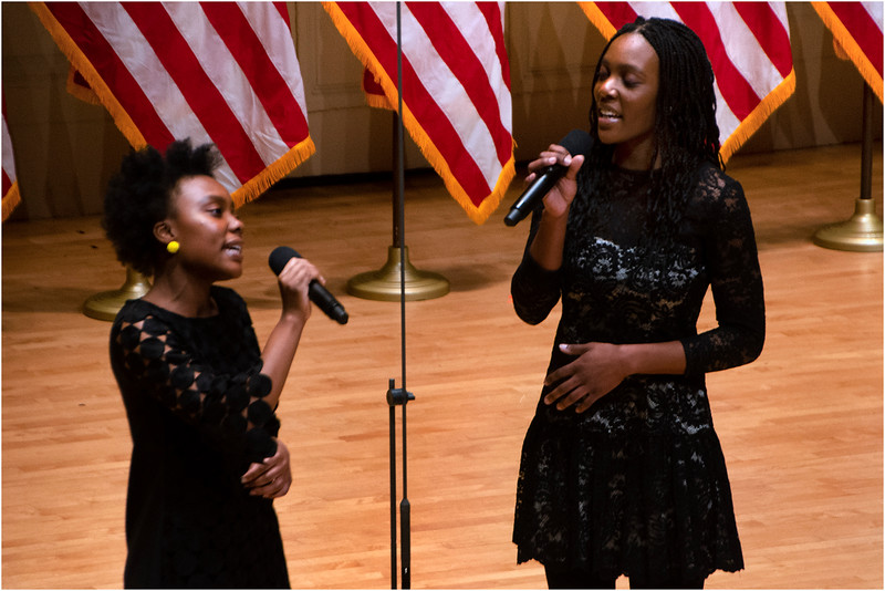 "Olayeni and Oladunni Oladipo performing ""God Bless America."""
