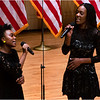 "Olayeni and Oladunni Oladipo performing ""God Bless America."""