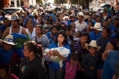 In the lead up to election day, the local PAN candidate holds a parade. Bussing in hundreds (if not thousands) of supporters, largely from rural and poor districts, they load them up with free swag. All of this is legal under the Mexican political system, and all major political parties engage in similar festivities.