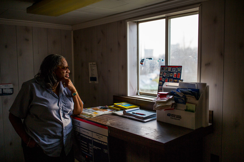 Carolyn Capozza runs the Ronco Post Office, which is open for two hours on weekdays, and three and a half hours on Saturday.  Although she thinks Ronco will never return to what it once was, she still sees a future for the patch in the kids who play basketball, ride their bikes, and walk down the street past her mailboxes.